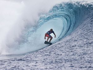 World's best surfers tackle dangerous Teahupo'o