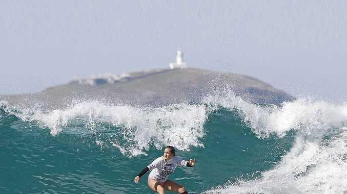 AUSSIE CHAMPION: Wooloweyah's Lily Ellis on her way to winning the Australian Under-18 Girls Longboard Title.