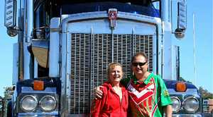 Lyn Shorten and Mark Hunter with one of Jay Reid's trucks which will be on display during the family fun day.