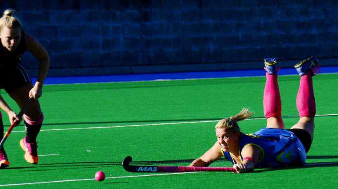 DESPERATE EFFORT: Senior Hancocks player Caitlin Sippel shows her determination, diving for the ball during hockey's Pink Sports Day earlier this year. Sippel is happy to accept more responsibility this season.