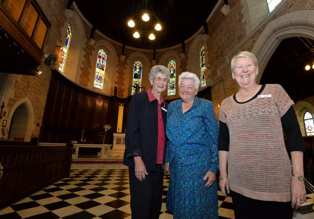 FOND MEMORIES: Vi Avenell, Thora Wilkie and Gail Bauer reminisce on the new Anglican primate of Australia, Melbourne archbishop Philip Freier being a former rector of the Bundaberg Christ Church. Photo: Zach Hogg / NewsMail