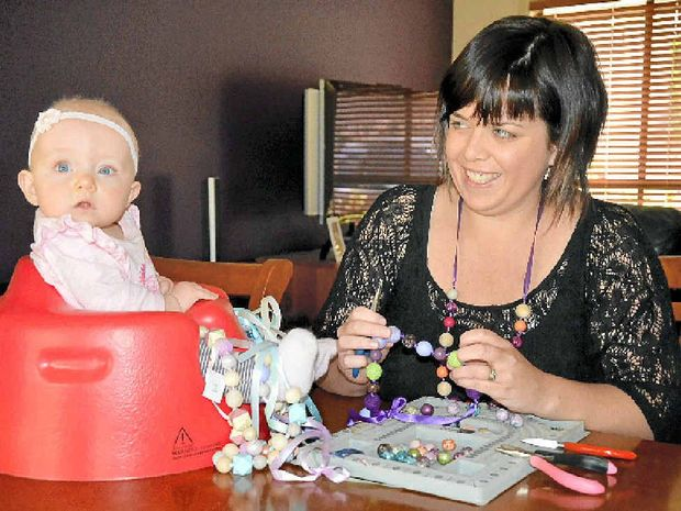 AWESOME NEWS: Mumpreneur and Valley Made Market coordinator Carly Mill makes jewellery at home in Grafton with her daughter Scarlett. She is looking forward to being able to buy stock from Spotlight.