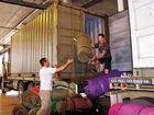 PACKED UP: Sergeant Nathan Pearse (left) and Leading Aircraftsman Nathan Ward load up the trucks for the Variety Bash.