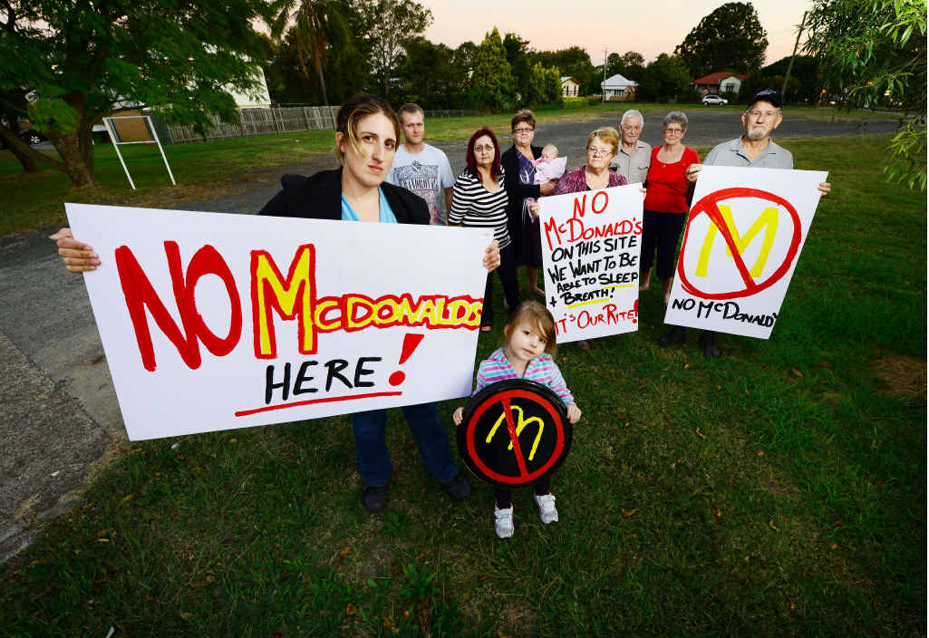 REWARD FOR EFFORT: Raceview residents led by Jessica McLean (left) protest the McDonald's proposal in May this year.