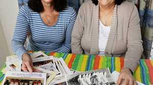 FOND MEMORIES: Michelle Sawyers and Gail Williams look through Coalstars memorabilia ahead of the club's 50th anniversary.