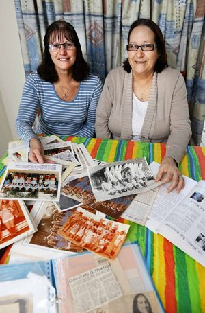 FOND MEMORIES: Michelle Sawyers and Gail Williams look through Coalstars memorabilia ahead of the club's 50th anniversary.