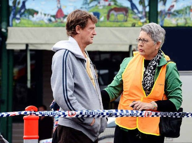 Lismore mayor Jenny Dowell talks to Nimbin Chamber of Commerce President Peter Wise in the wake of the fire which devastated Cullen Street.