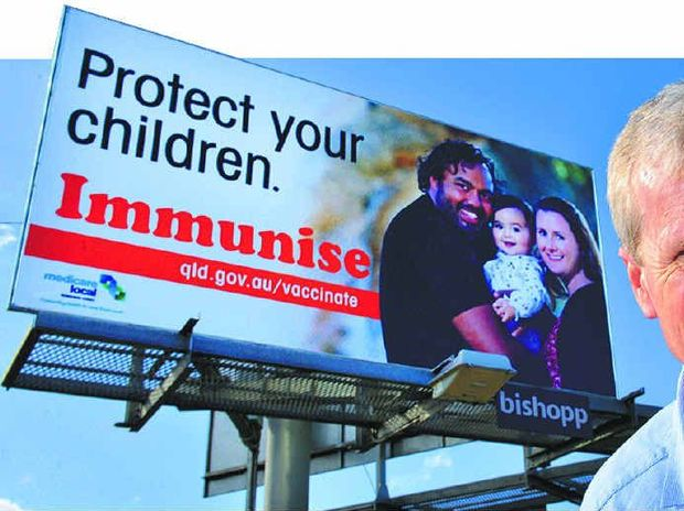 BILLBOARD CAMPAIGN: Dr Peter Dobson and one of the billboards designed to boost vaccination rates.