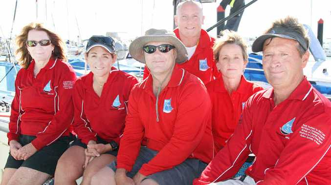 EXPLORING POSSIBILITIES: Crew members aboard the Sailors with Disabilities' yacht Kayle at Keppel Bay Marina.
