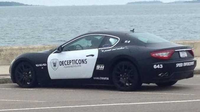 A Maserati resembling a police cruiser and Decepticon sits parked along the shore in Quincy, Massachusetts