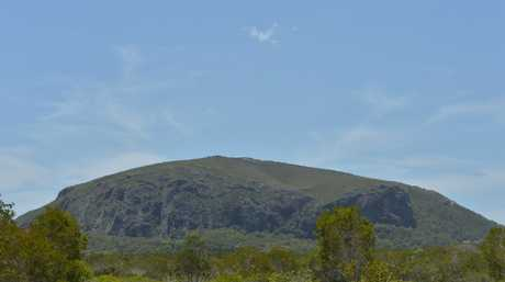 A man aged in his 50s has died while climbing Mount Coolum.
