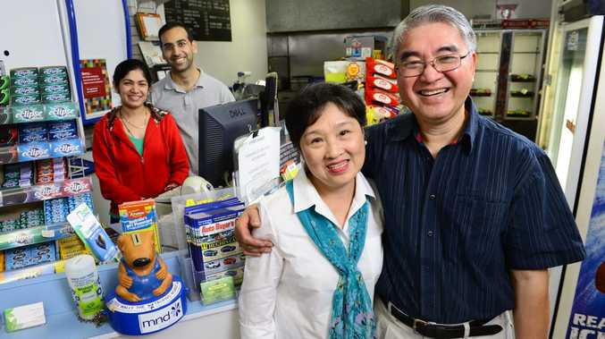TAKING OVER: Nguyen Dat and his wife Myle (front) have sold the Marburg News and General Store after 26 years of ownership to newly married couple Gaurav and Liza Khunger.