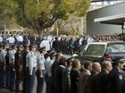 Queensland Police Service members form a guard of honour after the funeral of Det. Sgt Darren 'Beefa' Lees.