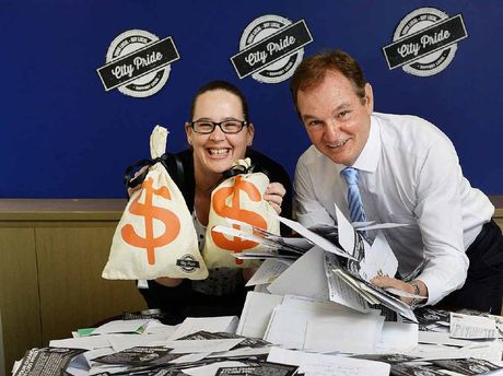 ENTRIES FLOOD IN: The Queensland Times features manager Rebecca Carter and Ipswich mayor Paul Pisasale get ready to draw the first City Pride winner from many thousands of entries.