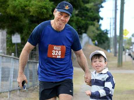 READY: Andrew Johanson and his inspiration, son Luke, enjoy a training run this week before the September 7 event.