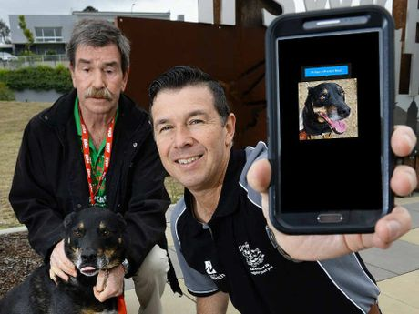 PRETTY FACE: RSPCA spokesman Michael Beatty and Cr Andrew Antoniolli check out the new Finding Rover app to locate missing dogs (image digitally altered).