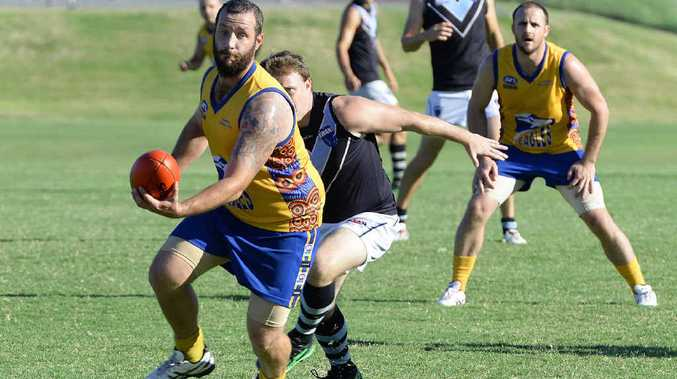 LOOKING FOR GLORY: Ipswich Eagles stalwart Chris Devlin takes control of the football, watched by captain Luke Konstanciak, during a recent game. The Eagles are hoping to keep their finals hopes alive by beating Pine Rivers today.