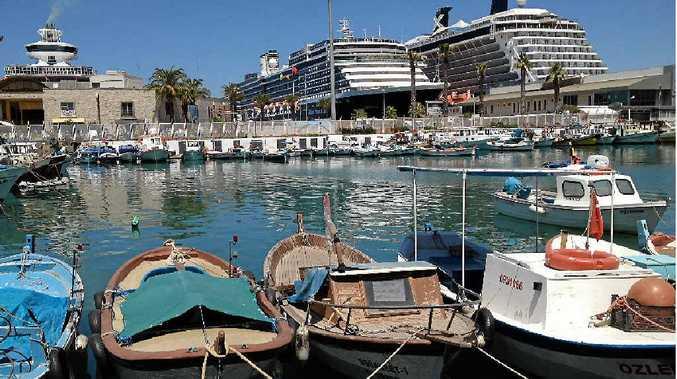 MEDITERRANEAN CRUISERS: Marina at Kusadasi in Turkey with three cruise ships in port.