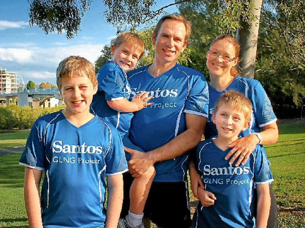 Santos GLNG's general manager downstream operations Brenton Hawtin with his wife Amanda and children Alex, JJ and Charlie, who are ready to hit the road for the Botanic to Bridge fun run.