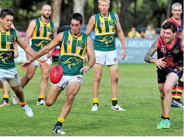 EARLIER THIS SEASON: Maroochydore's Jarrod Gale clears the ball from the backline as the Noosa Tigers close in.