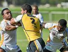 STRONG MAN: Falcons winger Joe Meninga pushes his way though against the PNG Hunters.