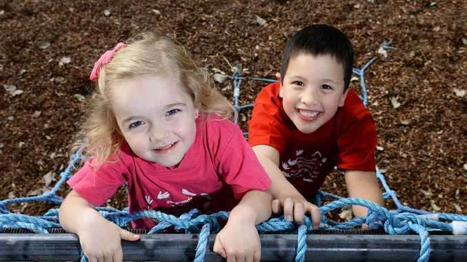 HAPPY: Lucy Day and Keegan Kamoto at the Jacaranda Kindy in Booval, which is celebrating its 35th anniversary.