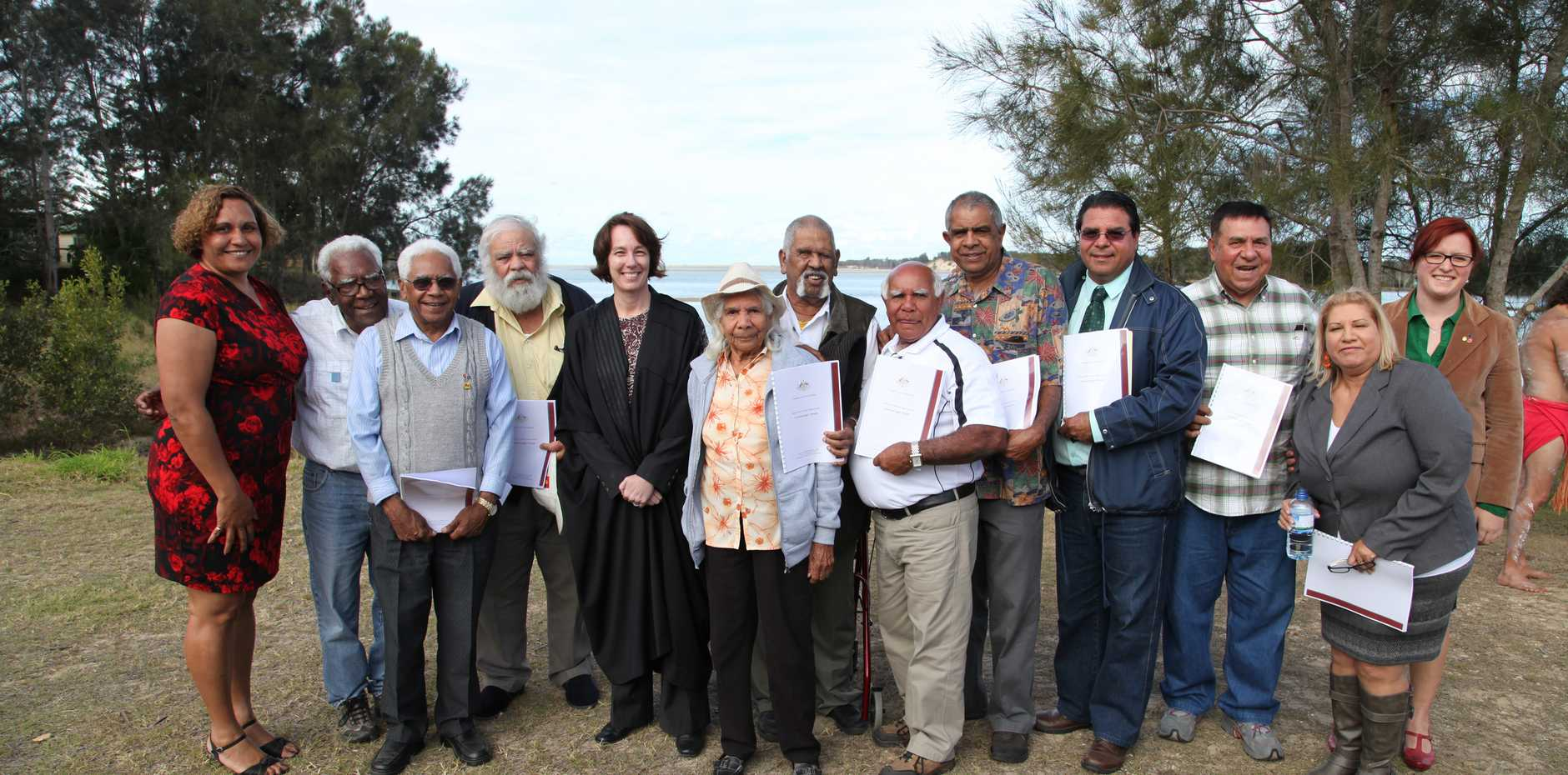 Justice Jayne Jagot (fifth from left) meets local elders after handing down the historic decision.