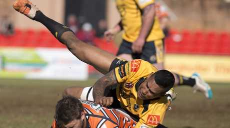 Steve Franciscus for Gatton tackles Andrew Gray for Souths, Gatton Hawks v Souths Tigers, TRL qualifying semi-final rugby league at Clive Berghofer Stadium, Sunday, August 17, 2014. Photo Kevin Farmer / The Chronicle