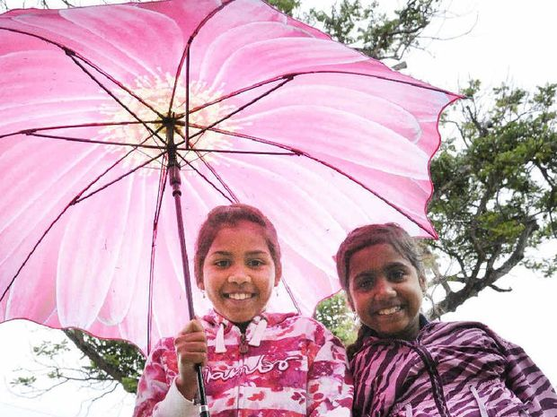 GLAD WE BROUGHT THE BROLLY! Maclean sisters Tamia Griffen, 10, and Alana Griffen, 9, were at Maclean Showground watching the last Magpie rugby league match of the season on Saturday.