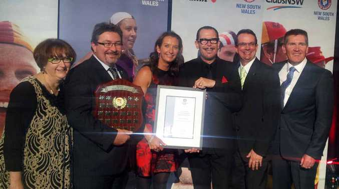 SURF AWARD: Ballina Lighthouse and Lismore Surf Life Saving Club representatives Sharon Balkin, Rod Balkin, Stephen Perris and Kris Beavis with Layne Beachley and Kirk Pengilly at the 2014 Awards of Excellence.