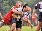 LOOKING TO OFFLOAD: The Toads' Shane Wright wraps up Noosa's Matt George at Woombye yesterday.