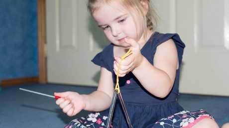 MUSIC TIME: A triangle is an instrument that children will enjoy. Photo: Contributed