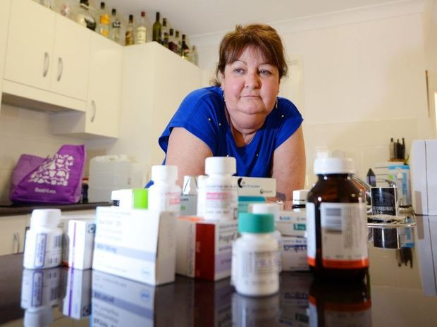 Anita Johnston received a lung transplant about four years ago but she is unlikely to survive into 2015 despite the plethora of drugs she needs to take. She is hoping to find the sister of the donor who she only knows as Gypsy. Photo: Chris Ison / The Morning Bulletin
