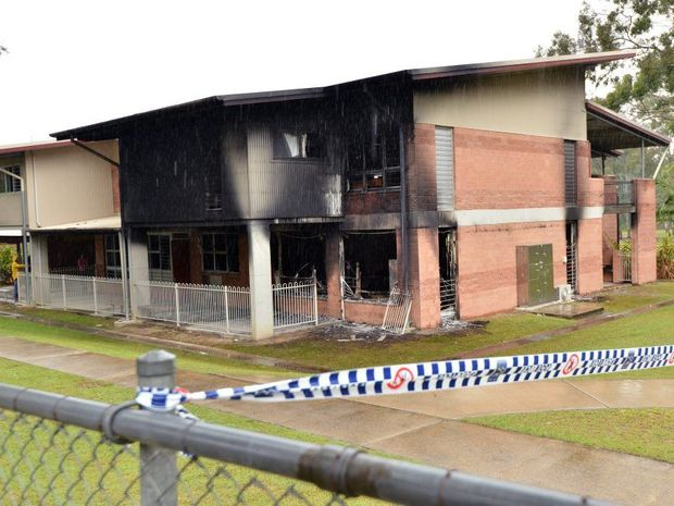 Bli Bli State School, prep, year one, year two, was gutted by fire last night. Families look on the senseless loss of school resources. Photo Patrick Woods / Sunshine Coast Daily