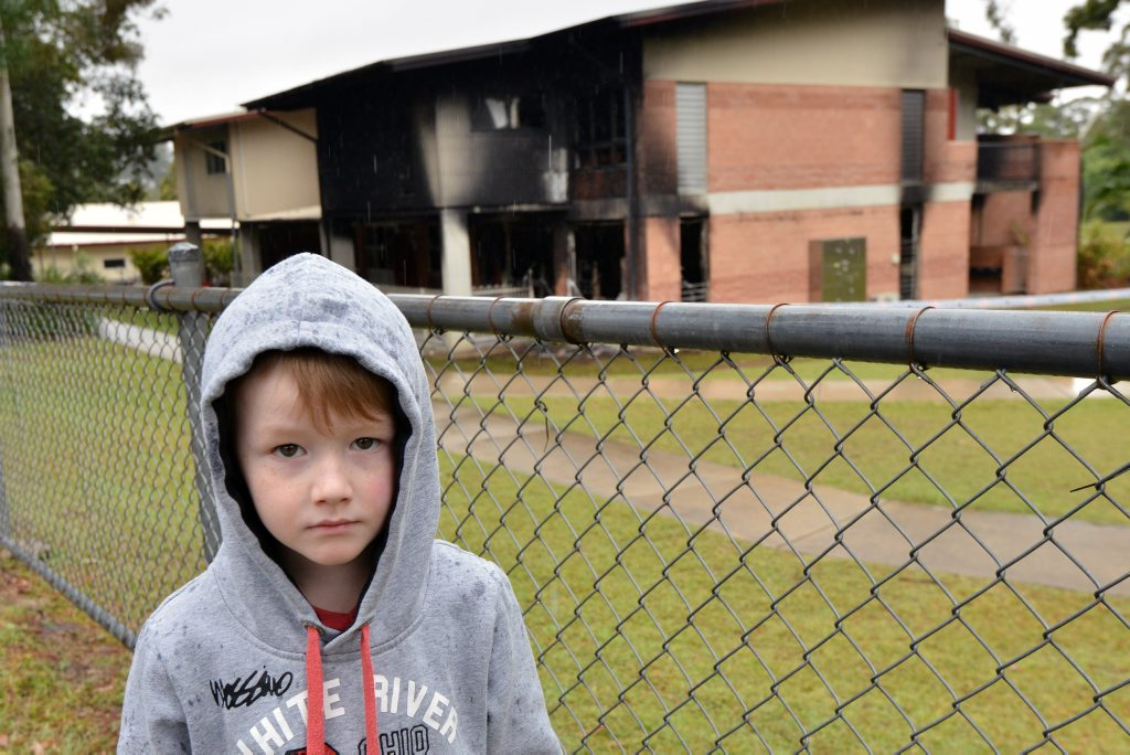 Bli Bli State School, prep, year one, year two, was gutted by fire last night. Hayden's Wells, 5yrs, first year of school, is sadden with the loss of school resources. Photo Patrick Woods / Sunshine Coast Daily