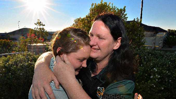 SHINE ON: Sharon Liddell hugs her daughter Shaye after listening to the poem that she wrote about their family's cancer.