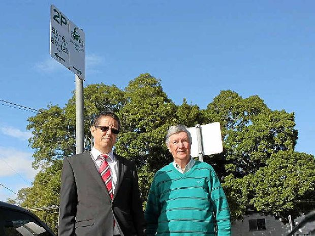 Lismore Council's Brent McAlister and Chamber of Commerce Chairman Art Beavis celebrate the return of two-hour parking to the CBD.