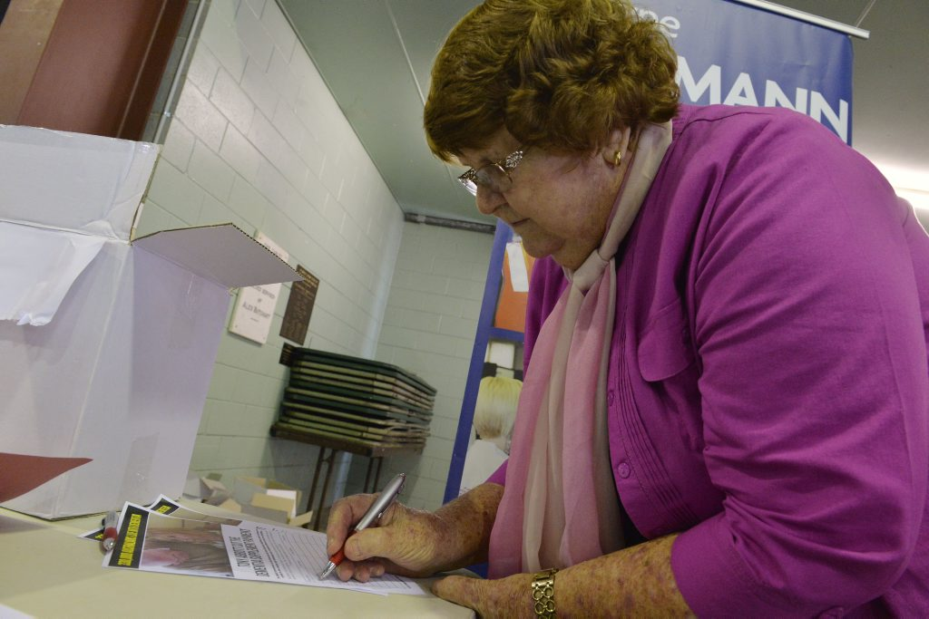BRING IT BACK: Peggy Frankish signs the petition.
