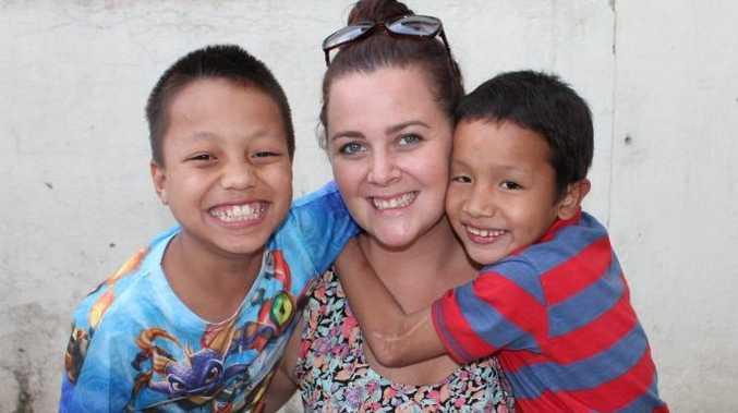 Kingfisher Bay Resort receptionist Bianca Lovelace in Nepal with underprivileged children Milan and Sandesh.