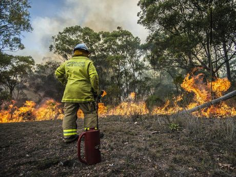Calliope 243A Firefighter Scott Wilson conducting backburning operations on a Beecher property, Gladstone.
