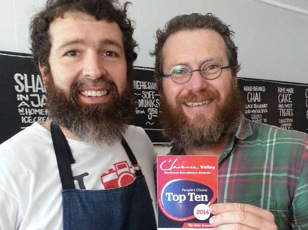 David and Tom of Irons and Craig, Yamba, receiving their People's Choice Top Ten sticker.