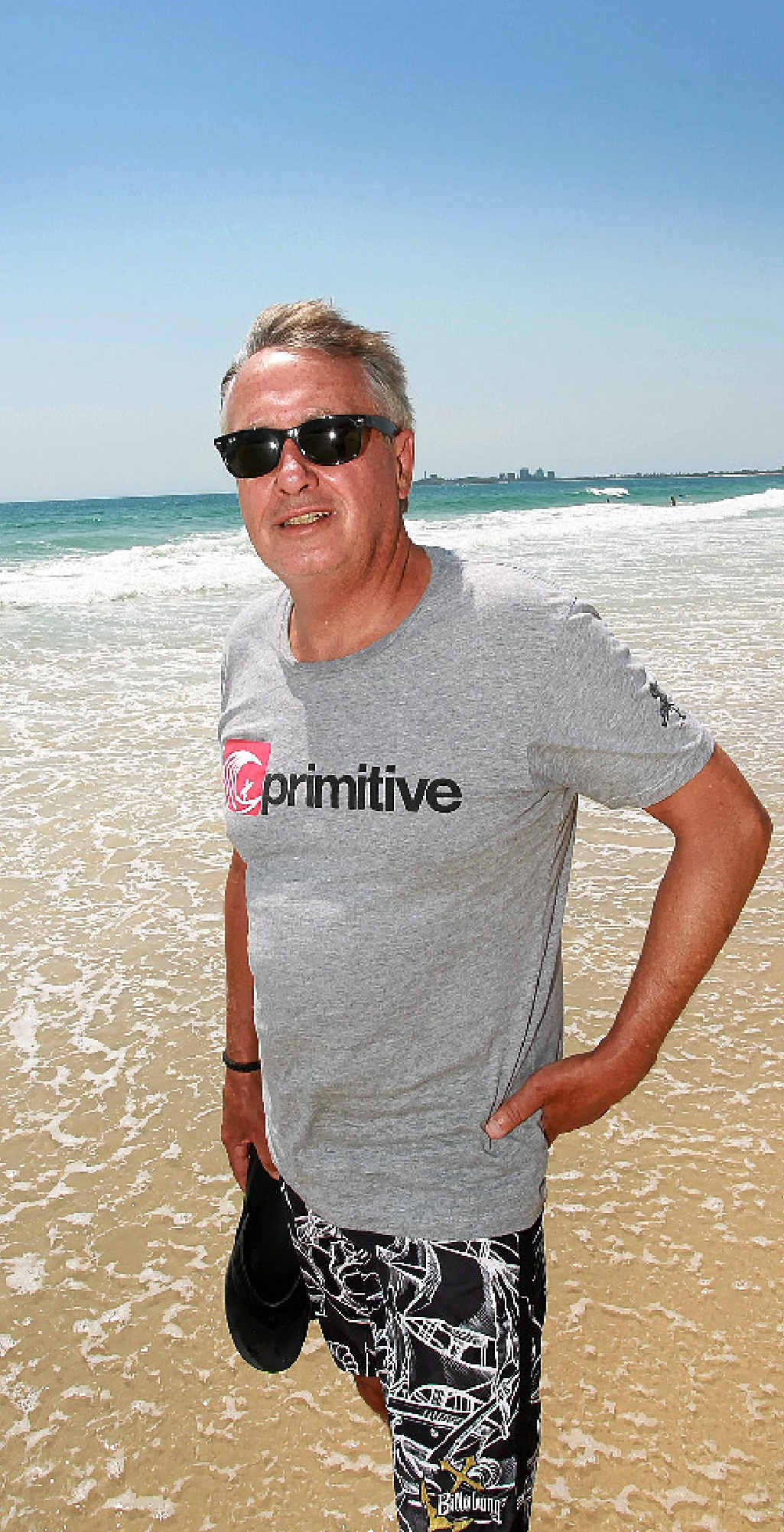 SPIRITUAL HOME: Wayne Swan wets his toes on a scorcher of a day at Maroochydore Beach.