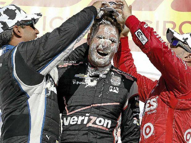 Juan Pablo Montoya and Tony Kanaan mash cream puffs into the face of Will Power.
