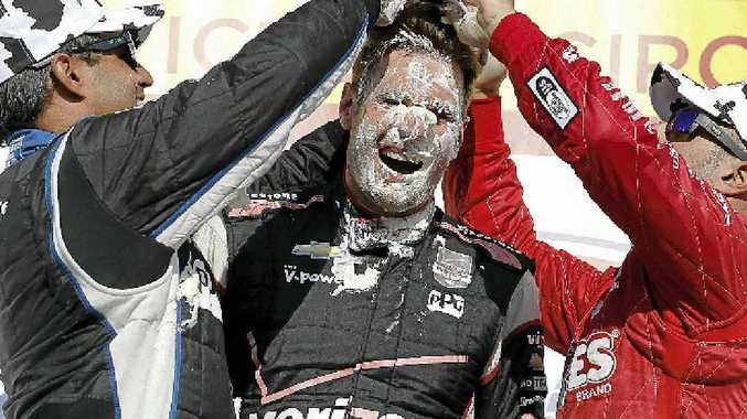 Juan Pablo Montoya and Tony Kanaan mash cream puffs into the face of Will Power.