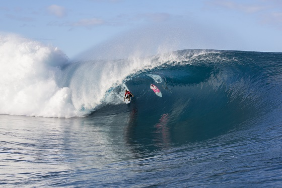 Kelly Slater (USA) threads a Teahupo'o monster as opponent Glenn Hall barely ducks under in Round 1 of the Billabong Pro Tahiti.