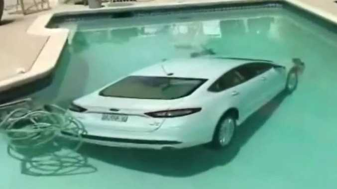 Car lands in backyard swimming pool after 85-year-old man tangles his thongs around the car's pedals