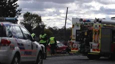 Emergency service at the scene of a serious traffic crash south of Warwick on the New England Highway.