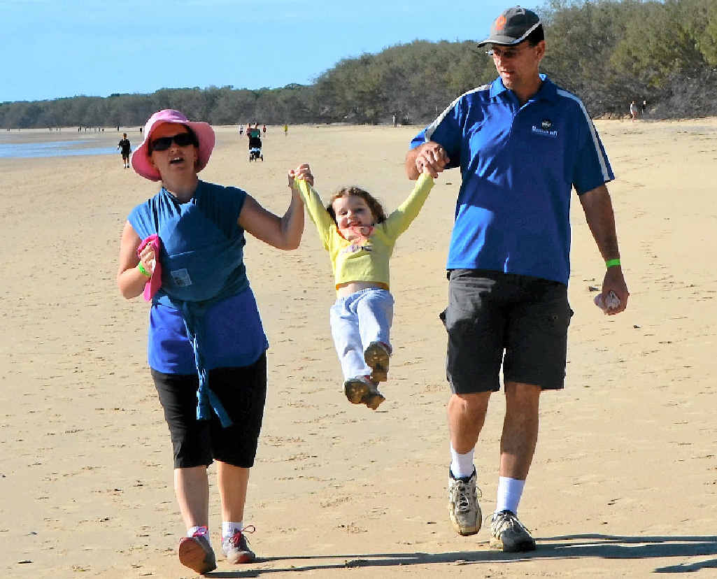 Emma, Emily and Dan Johnson, of Apple Tree Creek, have some fun on Sunday at Woodgate Beach participating in the fun run.