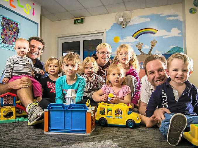 GREAT DADS: Gladstone Dads Playgroup members Dale Lawrence, Michael Trafford and Nathan Coombs with their children.