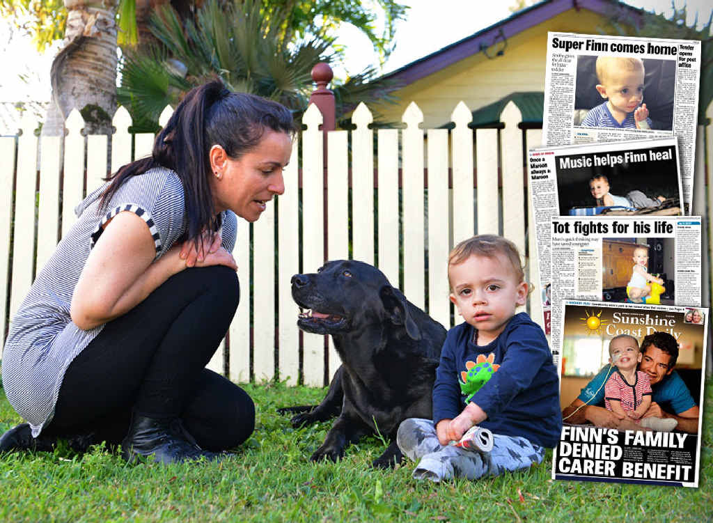 BIG DAY COMING: Young Finn Smith plays in the front yard with his mum Sarah and pet dog Easter.